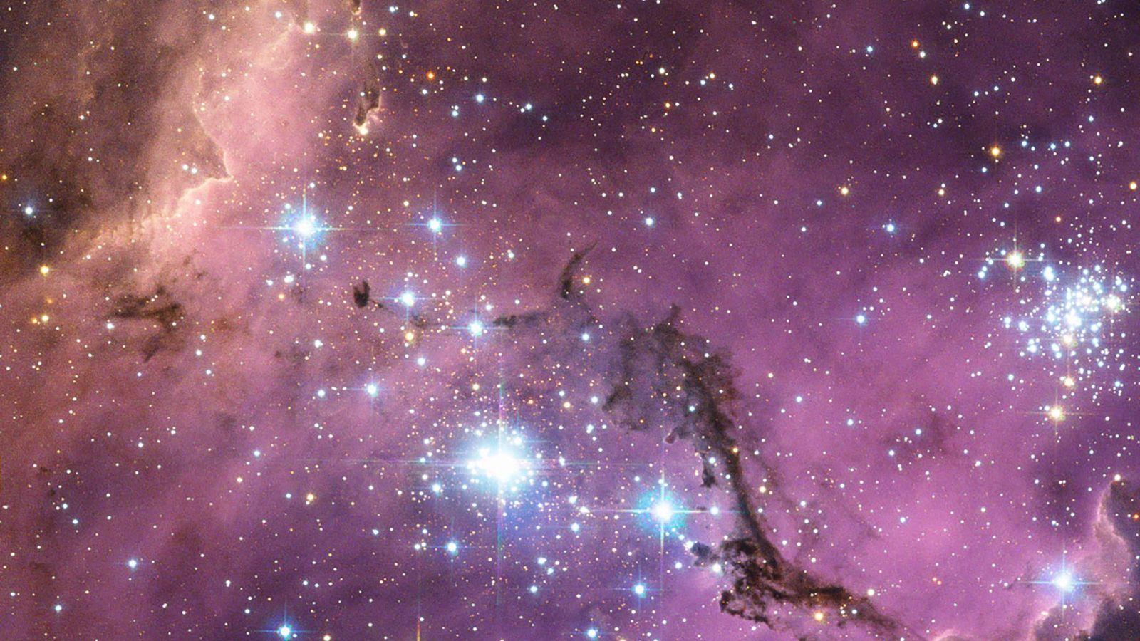 A quase 200 mil anos-luz da Terra, a Grande Nuvem de Magalhães —  uma galáxia ...