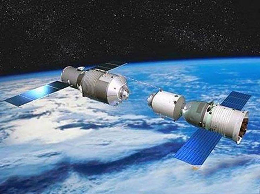 Uma cápsula tripulada se acopla à Estação Espacial Tiangong-1 em uma ilustração feita por uma estatal ...