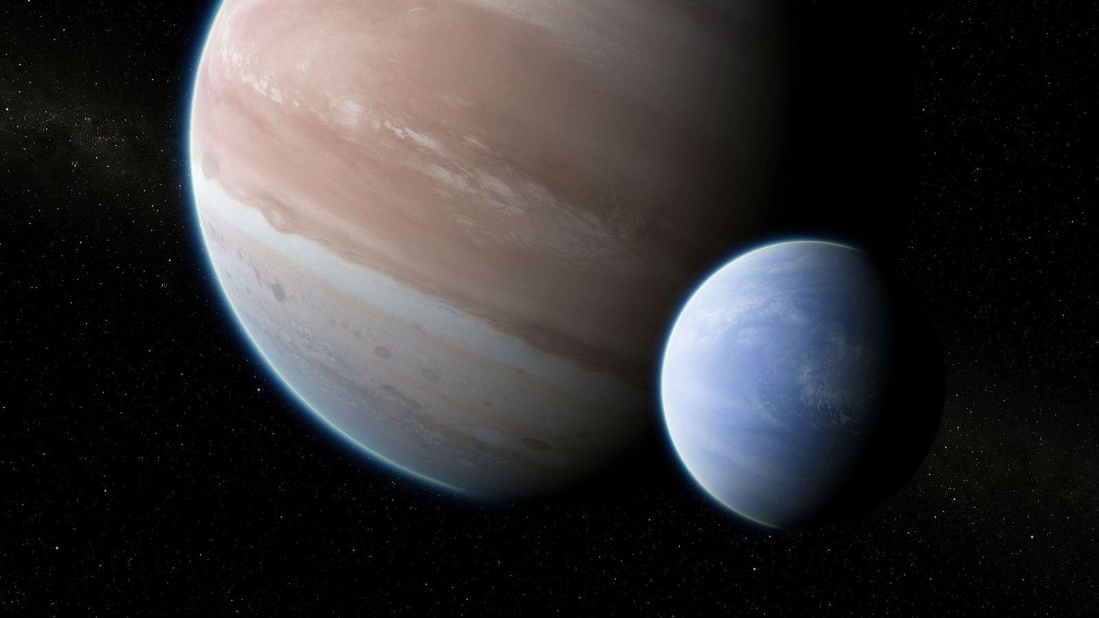 Nesta ilustração, uma grande lua orbita o planeta Kepler 1625b, que é do tamanho de Júpiter. ...