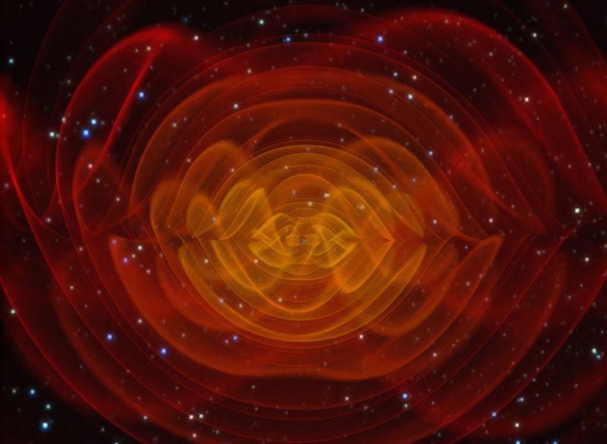Uma simulação de computador mostra as ondas gravitacionais emitidas pelos dois buracos negros espiralando um ao ...