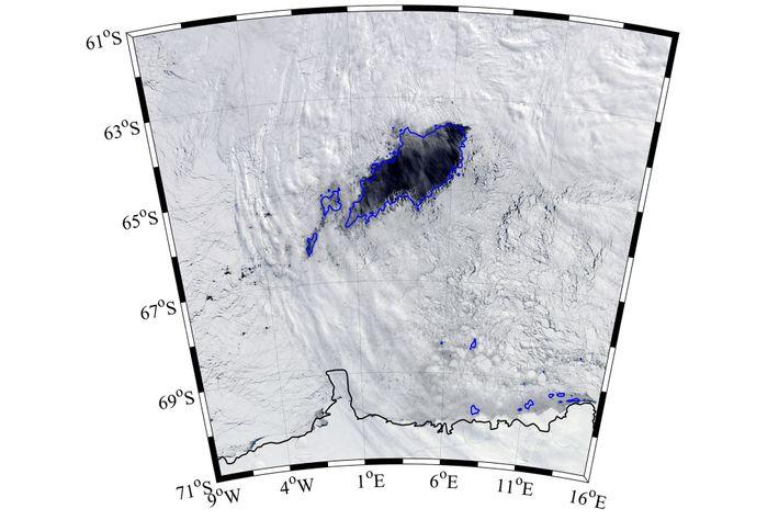 A linha azul representa as margens do gelo. A polínia é a região escura de mar ...
