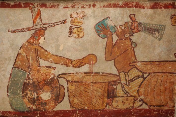 Ilustração da antiga cidade maia de Calakmul representa o preparo e o consumo do cacau.