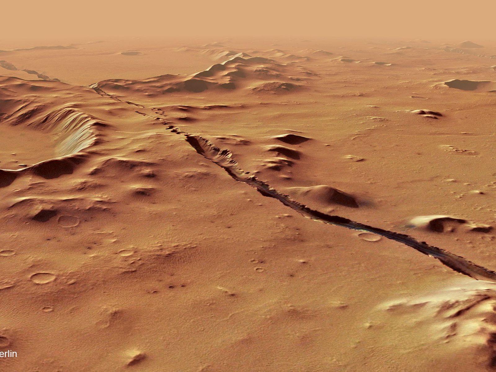 Essa fratura de Cerberus Fossae atravessa colinas e crateras preexistentes, o que sugere que o sistema ...