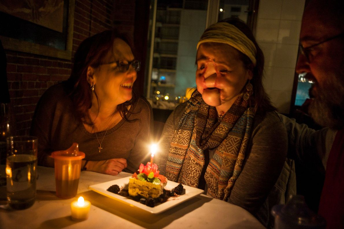 Celebrating Katie's 21st birthday, her mother tells her to make a wish and blow out the ...