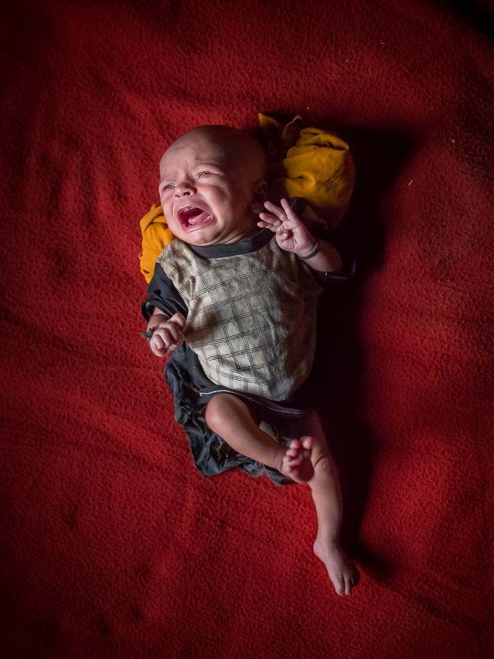 Um bebê ainda sem nome, de 15 dias de vida. Não possui cidadania de Mianmar nem ...