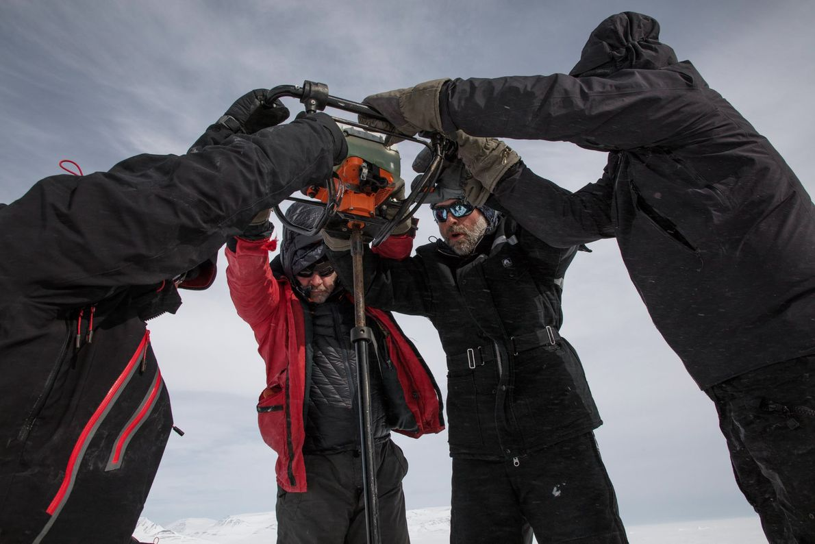The sea ice is often thick and difficult to penetrate. Here, a team cuts a 2-square-meter ...