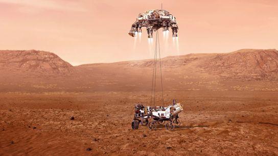 O rover Perseverance, da NASA, desce suavemente rumo à superfície de Marte, na cratera de Jezero.