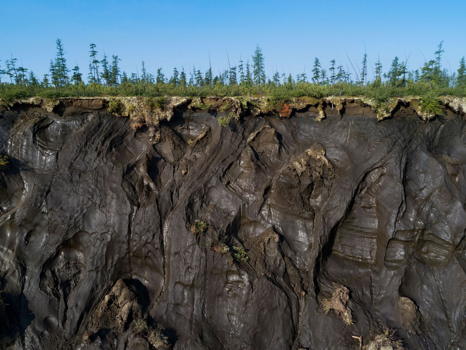 A cratera Batagaika, no leste da Sibéria, causada pelo degelo do permafrost, tem 800 metros de ...