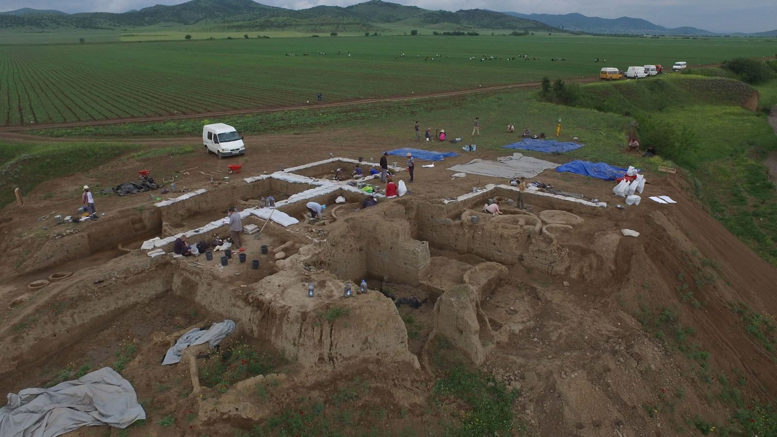 Archaeologists excavating this Neolithic village in the nation of Georgia found pieces of clay pots containing ...