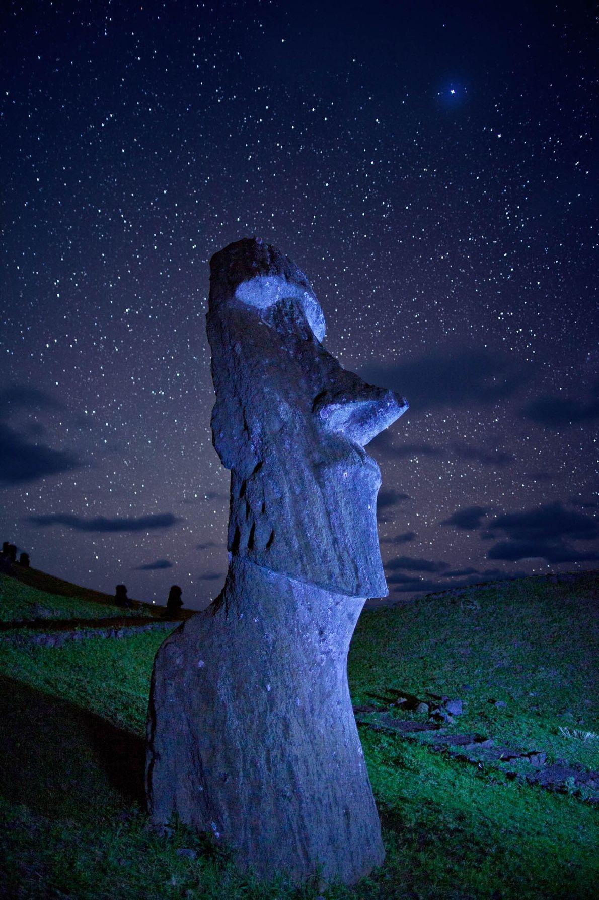 An ancient moai statue guards a hillside on Easter Island.
