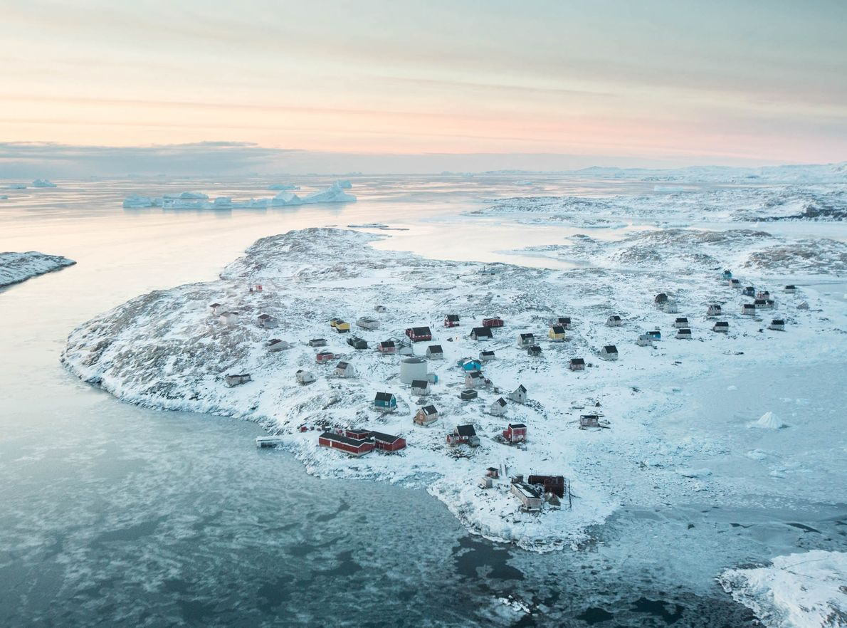 A large red supermarket is the center of the remote Greenland village of Isortoq.
