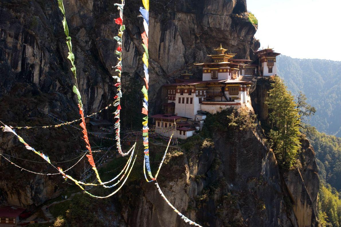 Prayer flags sway in the wind near Taktsang Monastery in Bhutan.