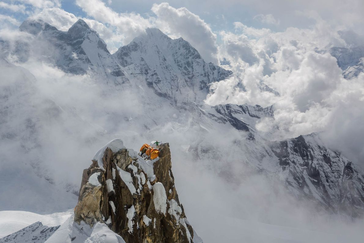 A sherpa fixes ropes on Ama Dablam mountain in the Himalayas of eastern Nepal.