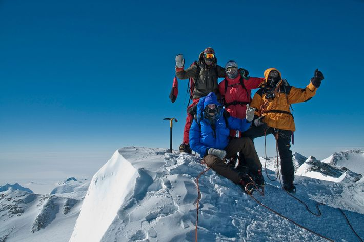 Andy Holzer and his team celebrate after reaching the summit of Antarctica's Mount Vinson.