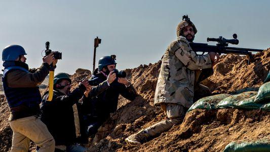 O improvável cotidiano dos fotógrafos de guerra