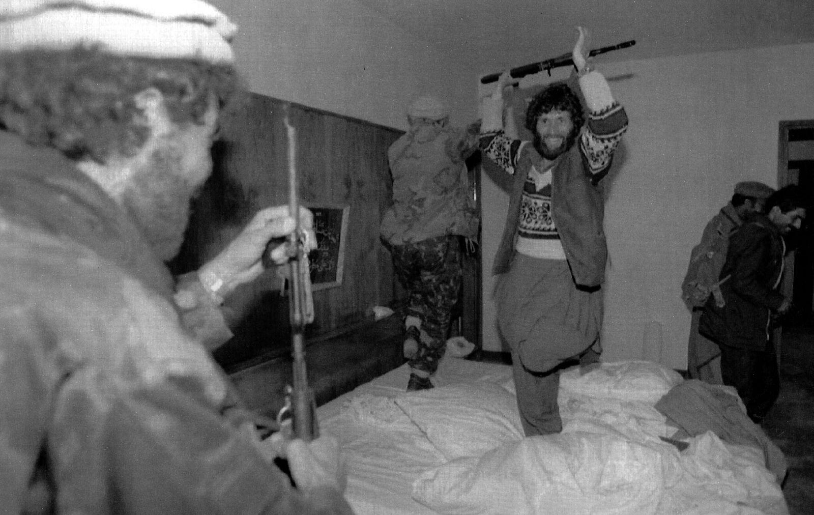 Mujahedeen dance in Najibullah's bed