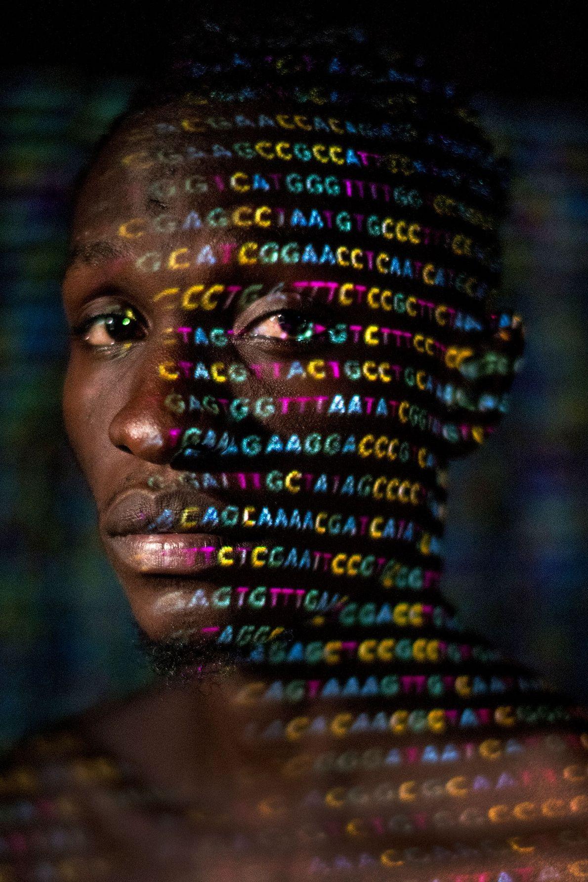 As quatro letras do código genético — A, C, G e T— são projetadas em Ryan ...