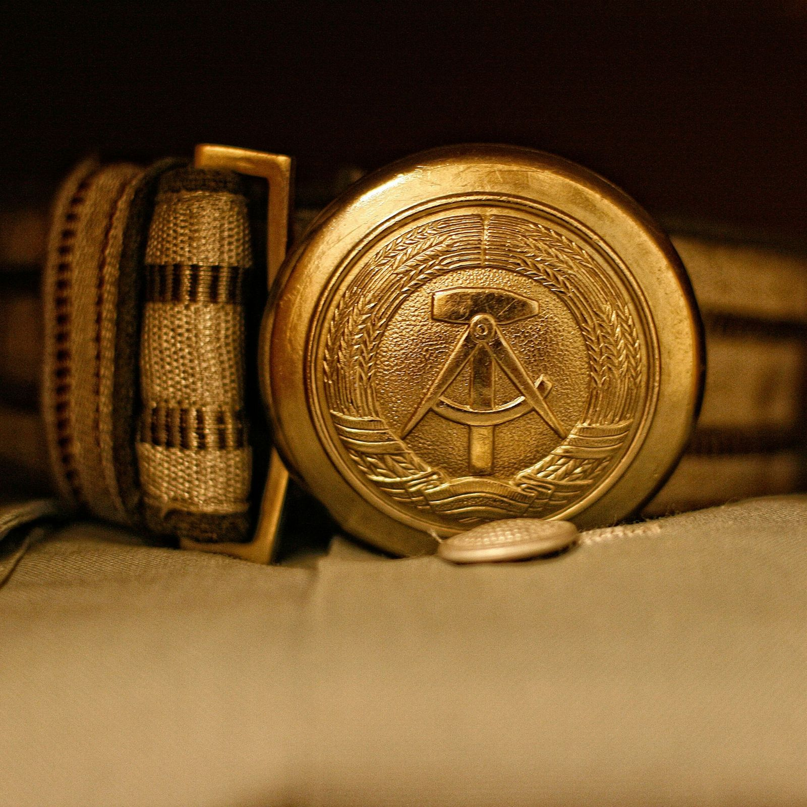 The national emblem of the former GDR stamped on a belt buckle which takes part of ...