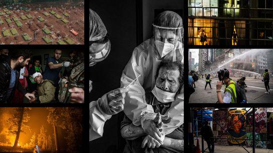Fotógrafos da National Geographic capturaram imagens que revelam um ano dominado por desastres, instabilidade social e ...