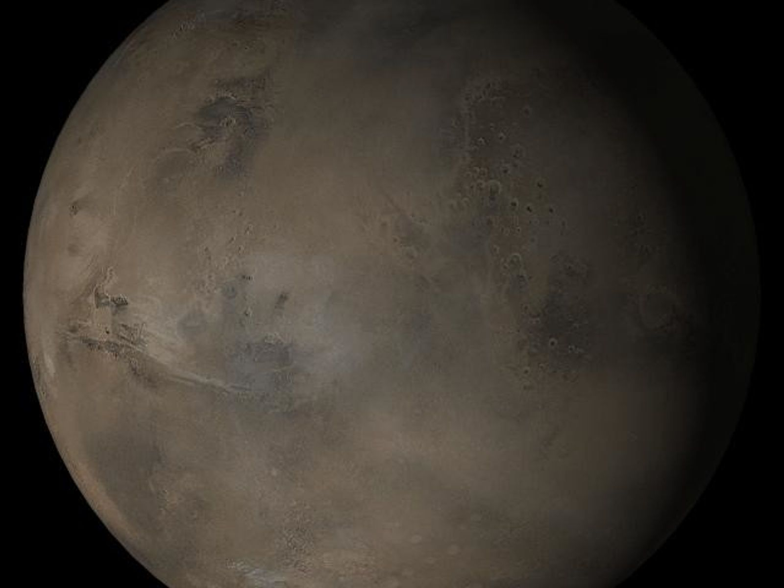 A composite image of Mars taken by NASA's Mars Global Surveyor in April 2005 shows the ...
