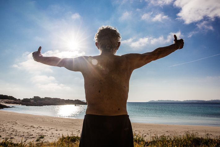 Morandi practices tai chi on the beach in the morning, absorbing the sun's rays and inhaling ...