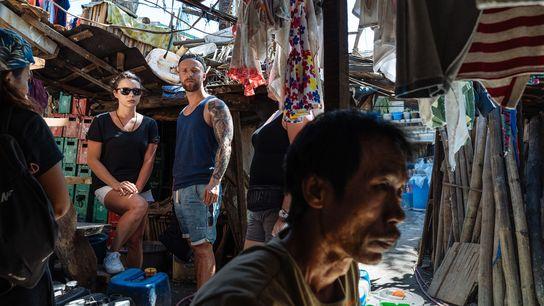 Turismo em favela, Manila, Filipinas.