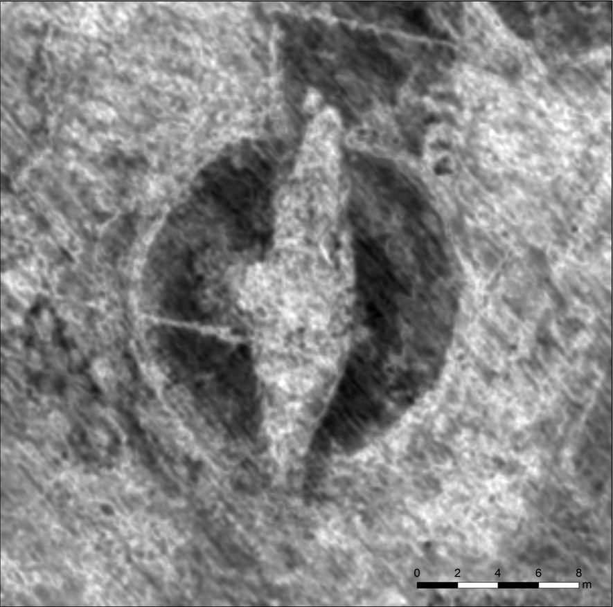 Uma imagem gerada por radar de penetração no solo revela a silhueta de um barco viking ...